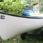 "16'4"" fiberglass canoe on cart"